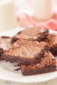 The best gluten free fudgy brownie recipe I have ever made! Rich and fudgy made with cocoa powder, they have the perfect flaky top.