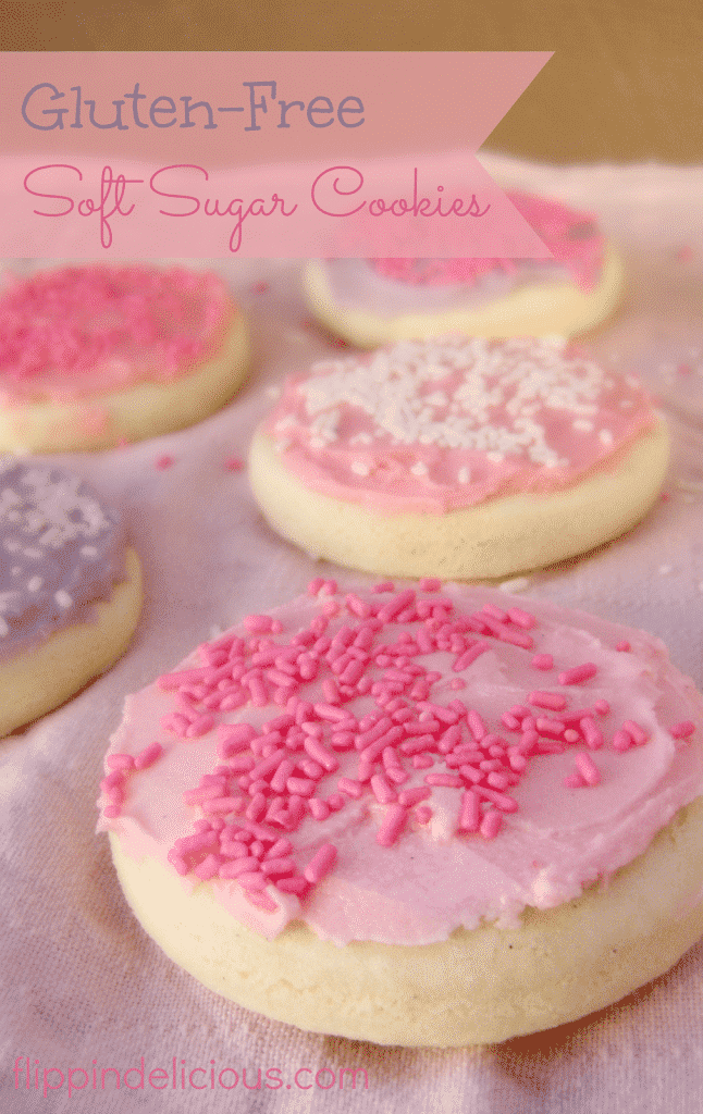 round gluten free sugar cookies topped with pink frosting and pink and white sprinkles