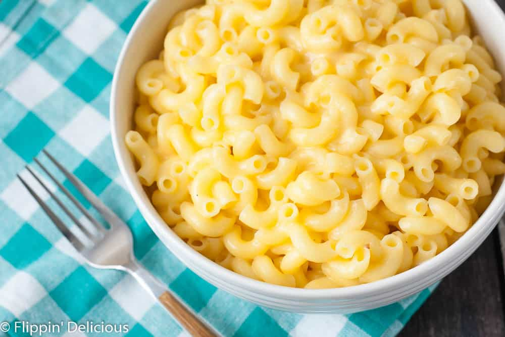 This gluten free one pot no drain mac n cheese is ready, start to finish, in 15 minutes. Easier than the box, and WAY better! Dairy-free option too. This recipe will change your life!