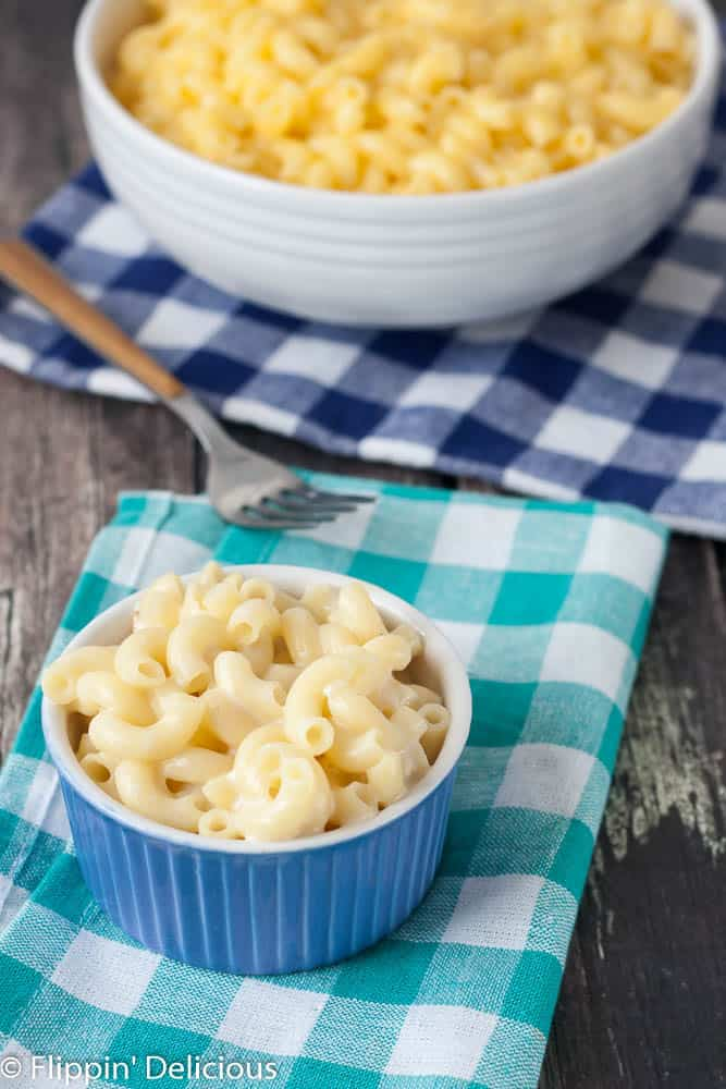 This DAIRY FREE gluten free one pot no drain mac n cheese is ready, start to finish, in 15 minutes. Easier than the box, and WAY better! This recipe will change your life!