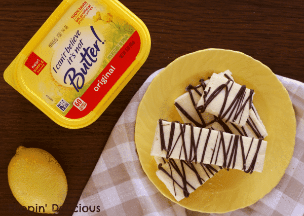 Gluten free lemon shortbread with chocolate drizzle are lightly sweet, crisp, and buttery. The lemon zest in the cookies makes them taste fresh and zingy.