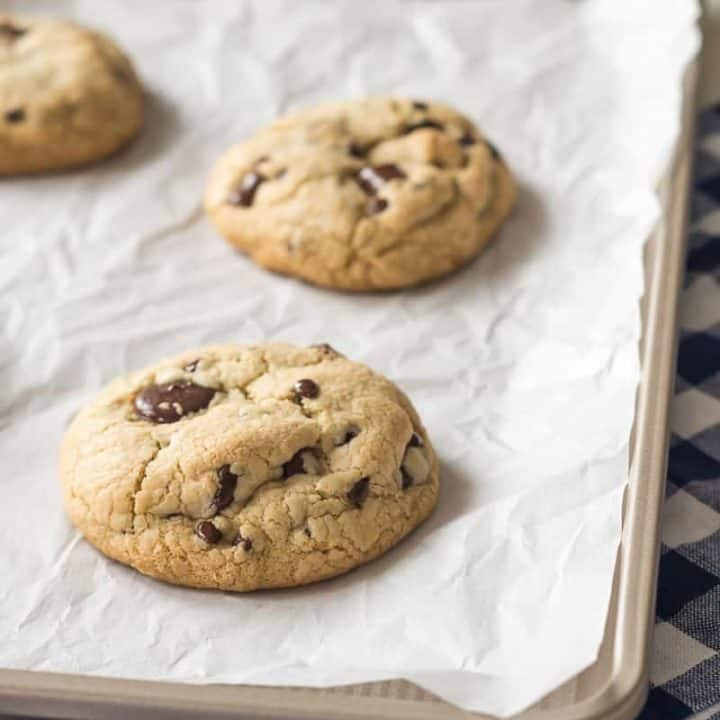 Giant gluten free chocolate chip cookies don't get any better than this! My favorite go-to soft baked, bakery-style gluten free chocolate chip cookie recipe. Easily made dairy free.