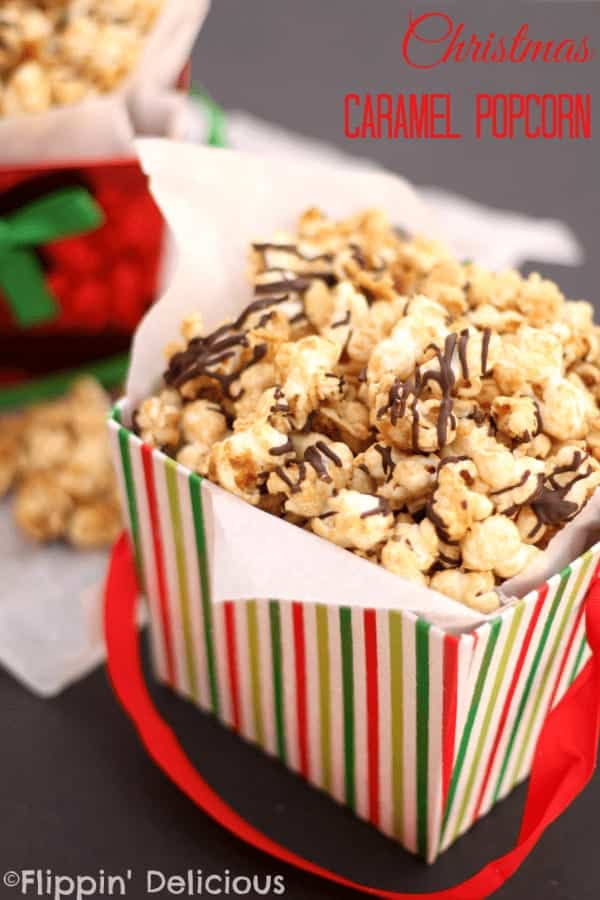 Christmas Caramel Popcorn with peanuts, coconut, and chocolate drizzled on top. Perfect for holiday gift giving!