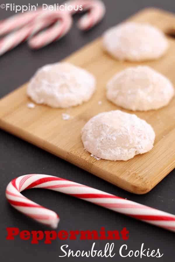Gluten-Free Peppermint Snowball Cookies are buttery, crisp peppermint cookies with crushed candy canes inside all rolled in sweet powdered sugar. Perfect for the Holidays!