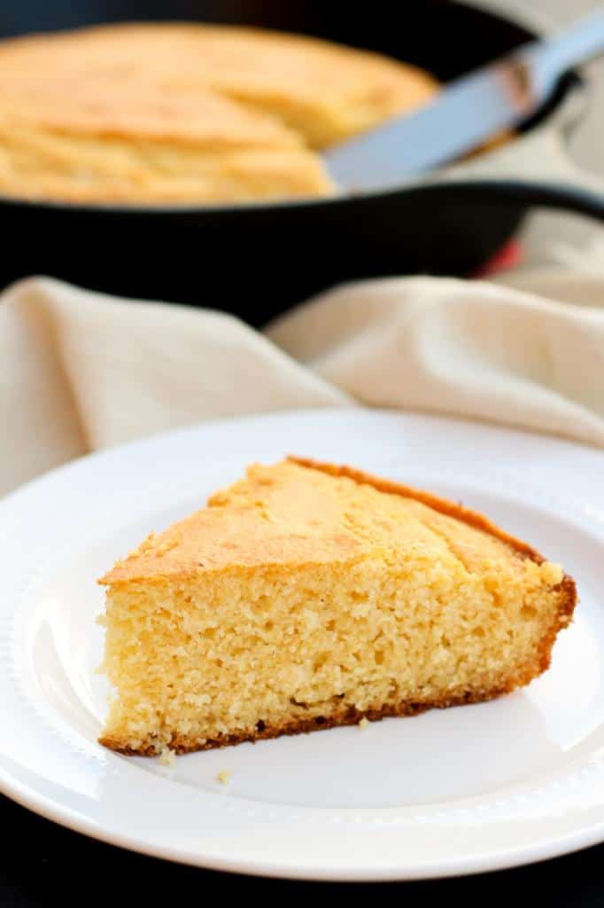 This sweet gluten free honey cornbread has chewy buttery edges and a great crumb. So easy to make, no mix needed! The perfect addition to a bowl of hot soup or chili.