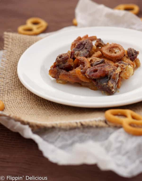 Gluten free pecan pretzel bars perfectly balance salty and sweet. Gooey, buttery, pecan filling over pecans, pretzels, and a shortbread crust.