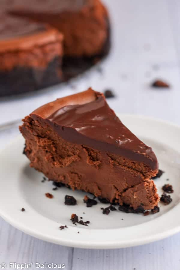 Gluten-free death by chocolate cheesecake is the ULTIMATE chocolate cheesecake and the perfect decadent dessert. Crunchy chocolate cookie crust with rich, creamy, chocolate cheesecake filling and topped with a sweet, smooth chocolate ganache.