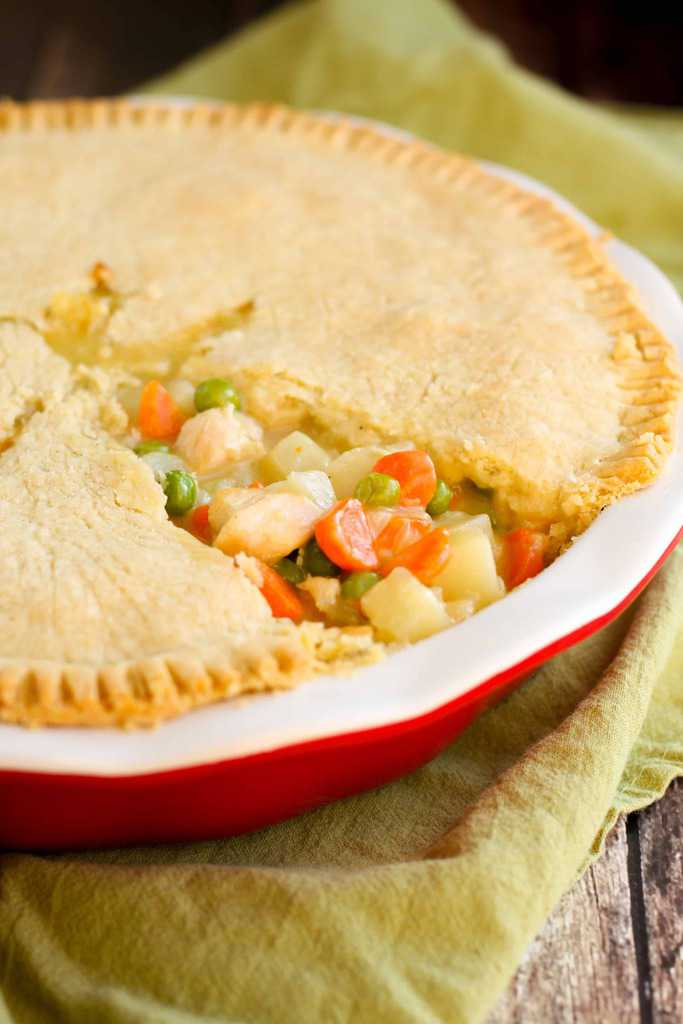 Creamy gluten-free chicken pot pie with a flaky gluten-free pie crust tastes just as good as you remember it. Peas, carrots, potatoes and chicken in a creamy gravy between two layers of buttery pie crust. It's almost too good to be true!