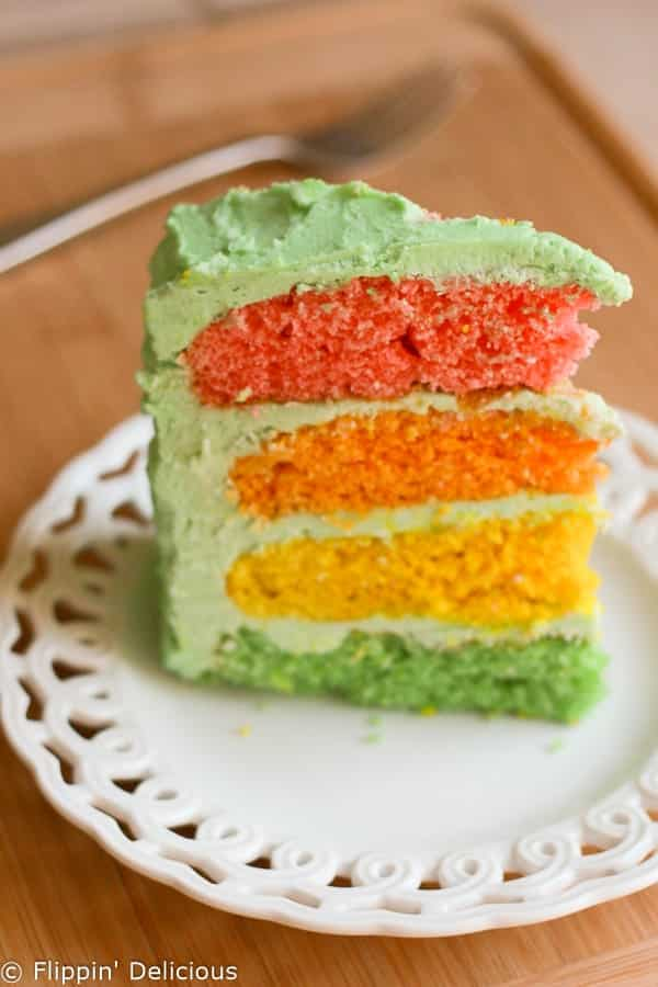 Gluten-free rainbow layer cake with buttercream frosting. Perfect for birthdays!