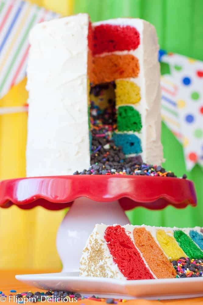 Sweet gluten-free rainbow layer cake with buttery frosting, perfect for a kid's birthday or any fun celebration. What is more fun than a bright colored cake that everyone can eat?