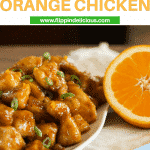 "gluten free orange chicken garnished with green onions, with a half of an orange, with text ""gluten free orange chicken"""