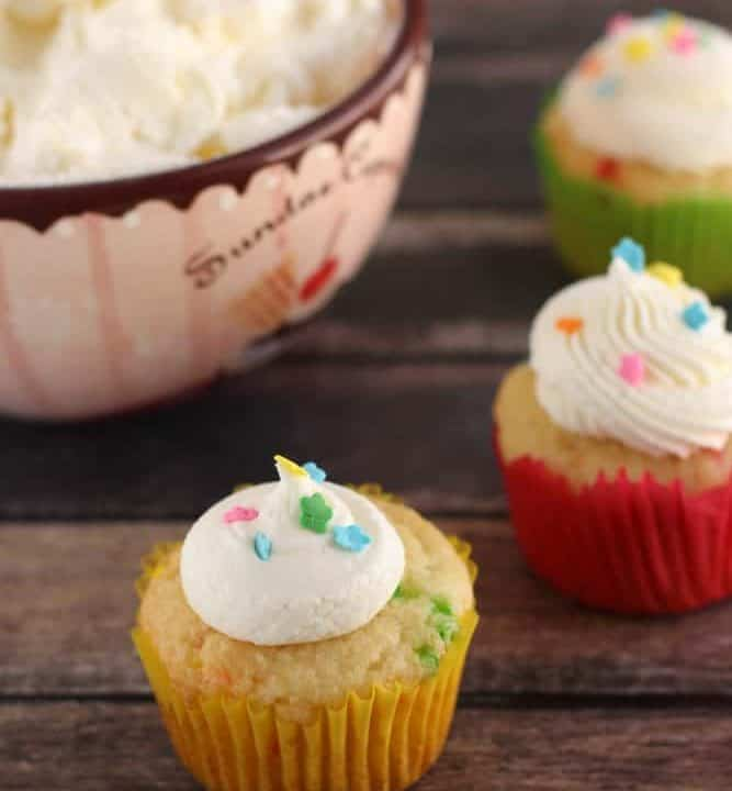 This Easy Homemade American Buttercream Frosting recipe will quickly become one of your favorites! Just 4 ingredients and it is so creamy and fluffy! Naturally gluten-free.