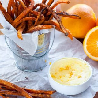 Crispy Baked Sweet Potato Fries with Orange Zest Icing Dipping Sauce. Crispy edges, velvety soft insides and a bright orange citrus icing to dip or drizzle on your fries however you want! Naturally gluten free and dairy free.
