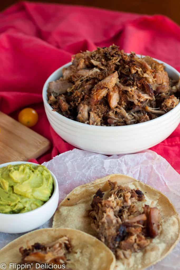 Nothing is easier than throwing these easy crispy carnitas in the slow cooker at lunch, and then enjoying them for dinner with some gluten free corn tortillas.