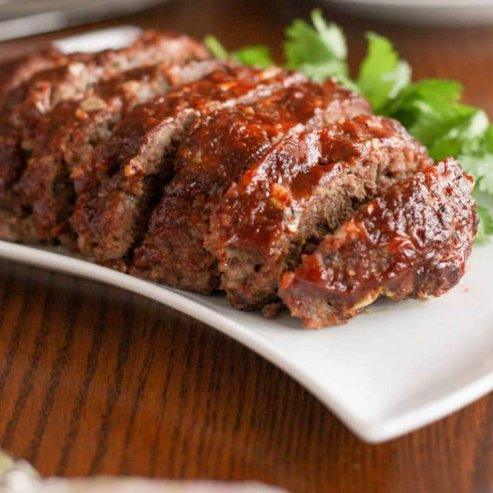 Gluten free slow cooker meatloaf is moist and tender, with a delicious crusty glaze. This is comfort food at its very finest!