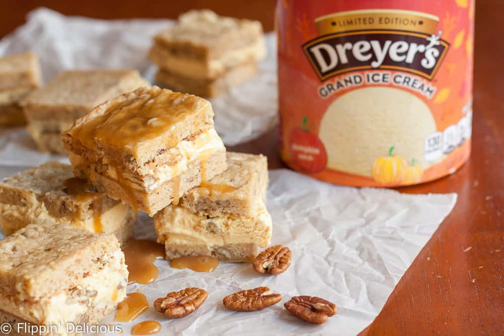 The Gluten Free Blondie Praline Pumpkin Ice Cream Sandwich recipe starts off with thin layers of chewy, buttery gluten free blondies, studded with pecans. When you add the creamy pumpkin ice cream it just gets better! Perfect for a unique post-Thanksgiving-feast sweet treat.