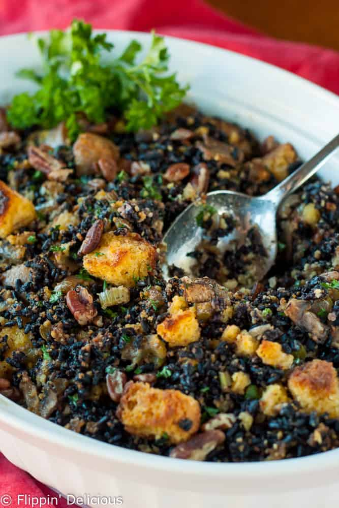 Perfect for your Thanksgiving feast, this gluten free cornbread dressing, cajun style with wild rice and pecans, is savory, nutty and just a little sweet.