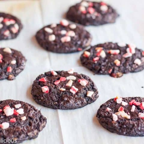 Flourless Chocolate Peppermint Cookies are easy, festive, and naturally gluten free. Just 7 ingredients in these flourless chocolate peppermint cookies!