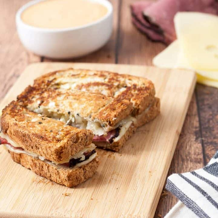 These Gluten Free Rueben Sandwich Dippers are my twist on the classic Rueben sandwich. Made with gluten free rye-style bread, pastrami, swiss cheese, sauerkraut, mustard and served with Thousand Island to dip. The perfect appetizer to share or hearty lunch!