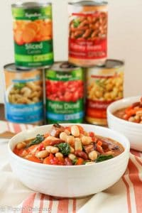 This hearty Tuscan 3 Bean Sausage Soup Recipe comes together in just a few minutes with very little prep time. It makes a perfect dinner for a busy weeknight!