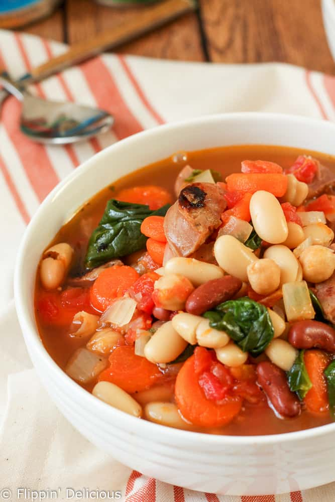 This hearty Tuscan 3 Bean Sausage Soup Recipe comes together in just a few minutes with very little prep time. It makes a perfect dinner for a busy weeknight.