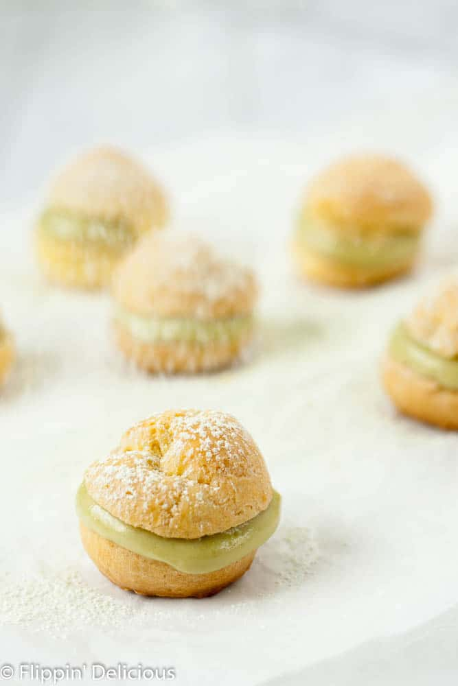 Light and subtly sweet gluten free matcha cream puff. All of the earthy flavors of matcha green tea in a smooth pastry cream inside of a buttery cream puff with a dairy free option.