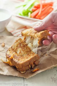 These Gluten Free Buffalo Chicken Grilled Cheese Sandwich Dippers have all the spicy flavor of your favorite buffalo chicken wings (with blue cheese) in a crispy grilled cheese sandwich that is perfect for dipping. Because dipping is half the fun of eating buffalo chicken wings!