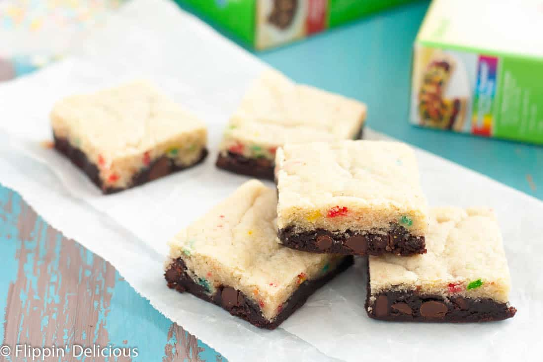With these Gluten Free Funfetti Brookies you don't have to pick between cookies or brownies! Finished off with some creamy fudge frosting and more sprinkles these are the perfect dessert to bring to any spring celebration or potluck!