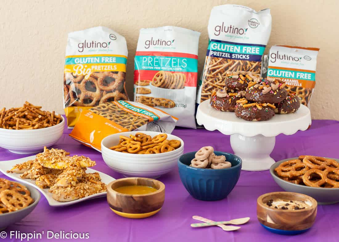 Gluten Free Pretzel Donuts rock the salty/sweet combo, complete with salted caramel pretzels and ALL THE SPRINKLES! Fluffernutter pretzel dip, and honey mustard pretzel chicken tenders… Celebrate #NationalPretzelDay with a gluten free pretzel party!