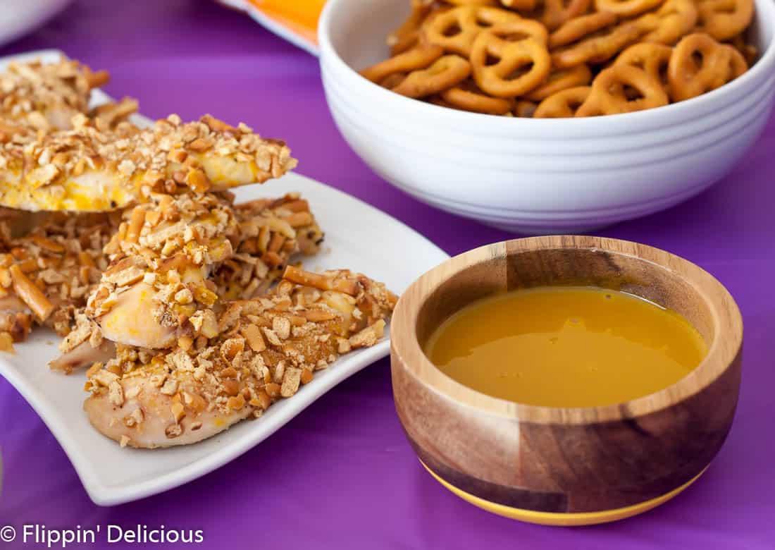 Honey mustard pretzel chicken tender perfect for celebrating #NationalPretzelDay with a gluten free pretzel party!
