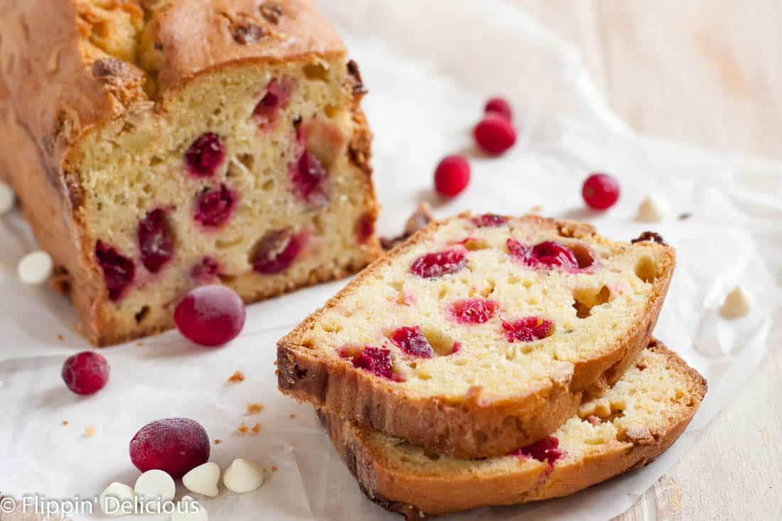 Moist gluten free cranberry bread with orange, white chocolate, and hazelnuts is the ultimate holiday quick bread! Dairy free option.