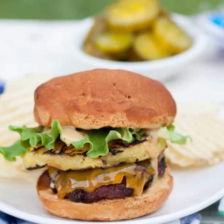 Gluten free teriyaki grilled pineapple burgers are the perfect twist for your next summer barbecue! Juicy beef hamburger patties rubbed with ginger-brown sugar rub, fresh grilled pineapple slices, and a creamy teriyaki mayo will make your mouth water!