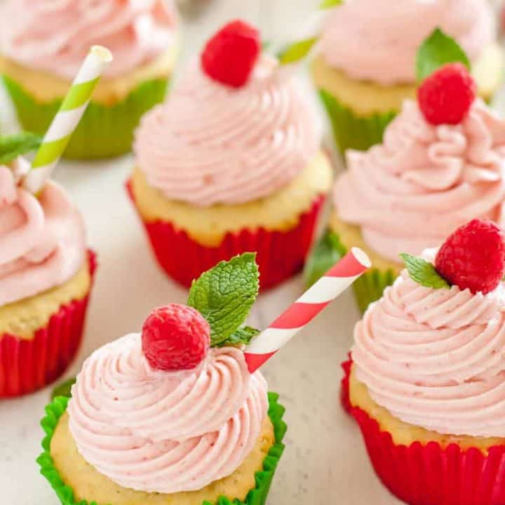 These gluten free raspberry lime mojito cupcakes are tender and sweet. Each bite will whisk you away to your favorite summer patio with a cold mojito in hand!