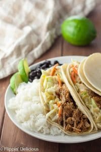 Gluten free pulled pork with green chile slaw is a flavor bomb in your mouth! Use it for tacos, sandwiches, salads… anything!