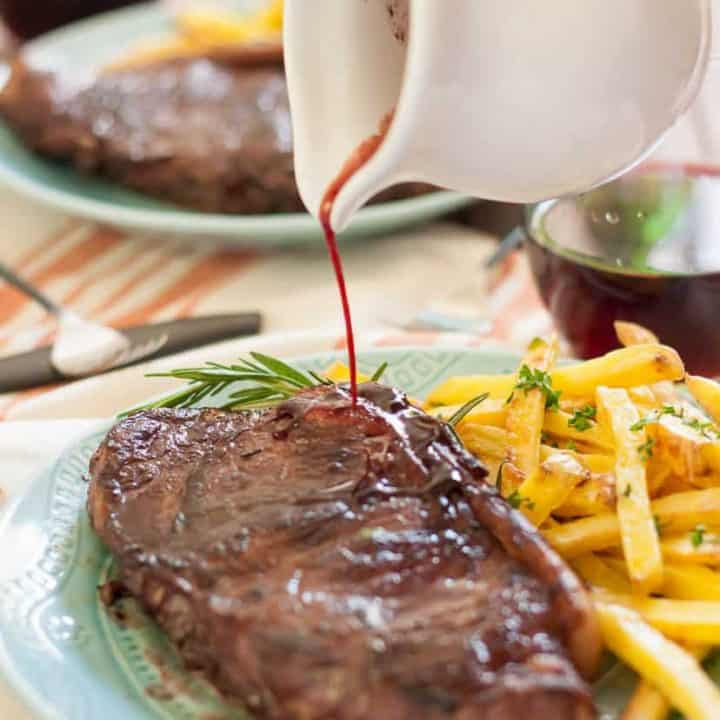 Juicy new york strip steaks marinated in red wine, rosemary, garlic and shallots with garlic and herb baked fries make a perfect at home date!