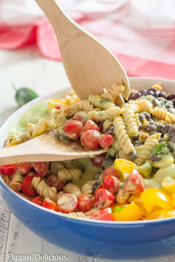 Gluten free southwest pasta salad has a kick you won't get from a regular pasta salad! It's perfect for summer potlucks.