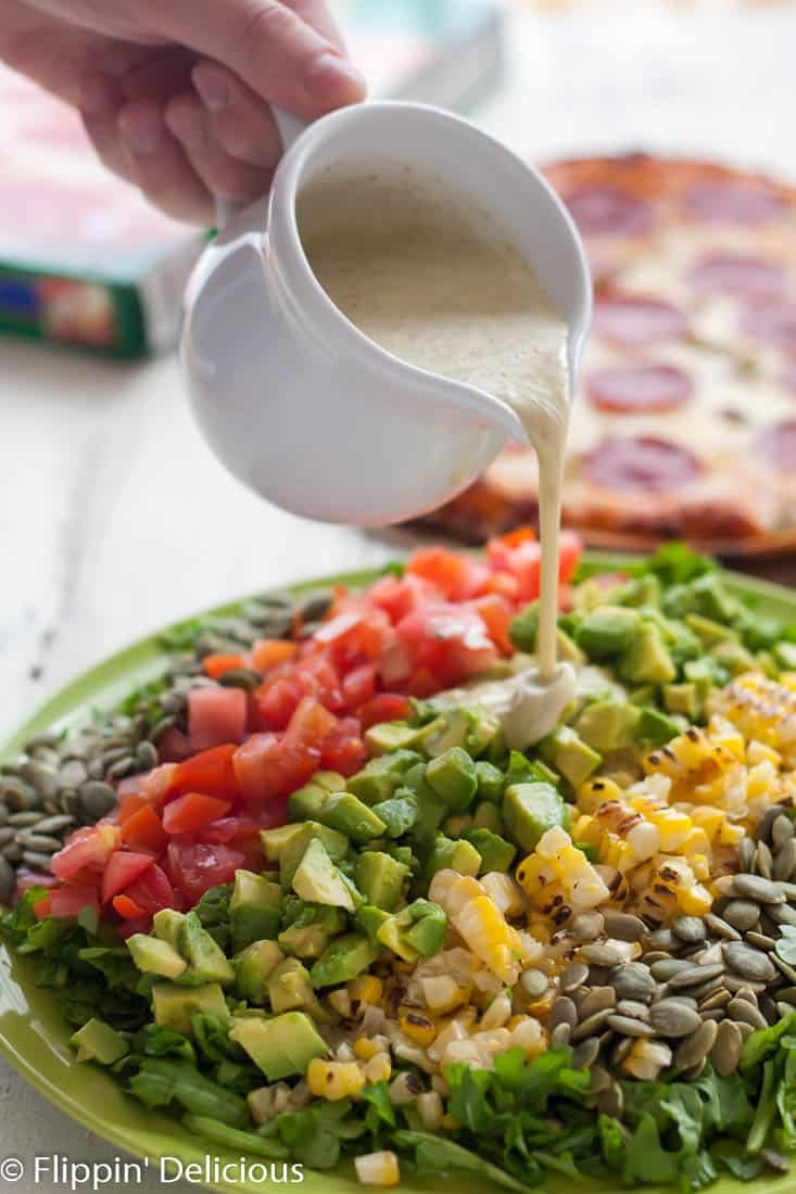 This New Mexican Chopped Salad with Hatch Green Chile Vinaigrette makes the perfect weeknight meal when combined with gluten free green chile pepperoni pizza!