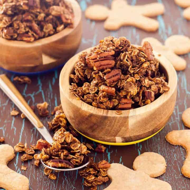 Gluten Free Gingerbread Granola takes just a few minutes to mix up, has only 9 ingredient and is perfectly spicy and sweet! If you are a granola fan, you are in for a special treat! When I was growing up my family almost always had a cannister full of homemade granola. Our recipe was simple and we made it exactly the same way every time. Oats, honey, oil, molasses, coconut, sunflower seeds, water, and wheat germ. I remember measuring the ingredients with my mom. We'd mix them all together in our biggest metal mixing bowl, and then we would bake the granola for several hours IN our mixing bowl, stopping to give it a big stir every 20 minutes or so. I actually hated eating the granola. I hated the sunflower seeds and would pick them all out before adding milk to my bowl. As you can imagine that made breakfast take a LONG time! As I grew up I was astounded at the different homemade granola recipes that people create! On Flippin' Delicious I have gluten free oatmeal cookie granola, gluten free salted caramel granola and gluten free pumpkin granola recipes. My granola recipe repetiore pales in comparison to the granola recipe arsenal that Leah from Grain Changer has on her blog. Just a few days ago she shared a recipe for Apple Pie Granola! Leah loves granola, which is why some of my friends and I have gathered to shower her and her new baby with granola recipes! Granola Baby Shower Oat Free Granola from There is Life After Wheat Gluten Free Gingerbread Granola from ME Lemon Blueberry Granola from Thoroughly Nourished Life Maple Walnut Cinnamon Granola from Fit Mitten Kitchen Chai Spiced Granola from Fresh April Flours Coconut Granola from The Emotional Baker Tropical Hempseed Granola from A Clean Bake I brought this gluten free gingerbread granola to the party. It takes just a few minutes and 9 ingredients to make this sweet and spicy ginger granola. I add extra ginger to mine because I like it spicy like my favorite gingersnaps. If you are a fan of satisfying clumps in