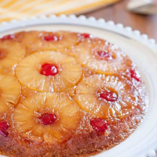 Gluten Free Pineapple Upside Down Cake is a classic dessert with gooey brown sugar, pineapple rings, and cherries. Dairy free option!