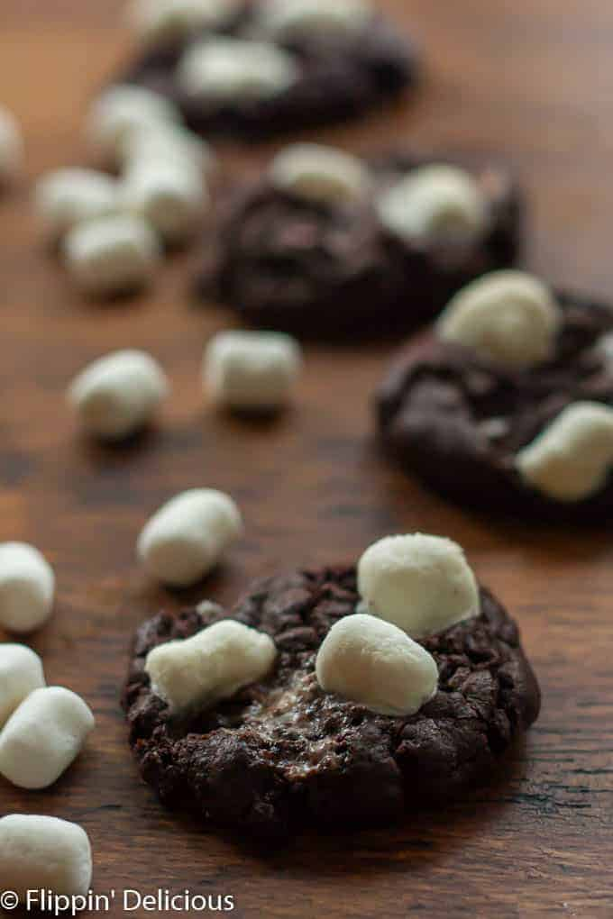 These gluten free hot chocolate cookies are made without any flour and are full of gooey melted marshmallows just like your favorite winter beverage.