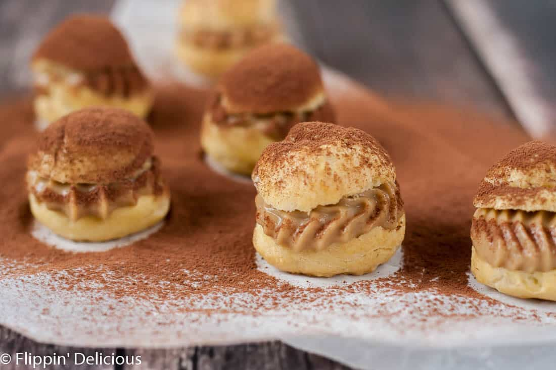 Gluten free tiramisu cream puffs have all the flavors and textures of the classic Italian dessert in a fun bite-sized dessert. The perfect pick-me-up!