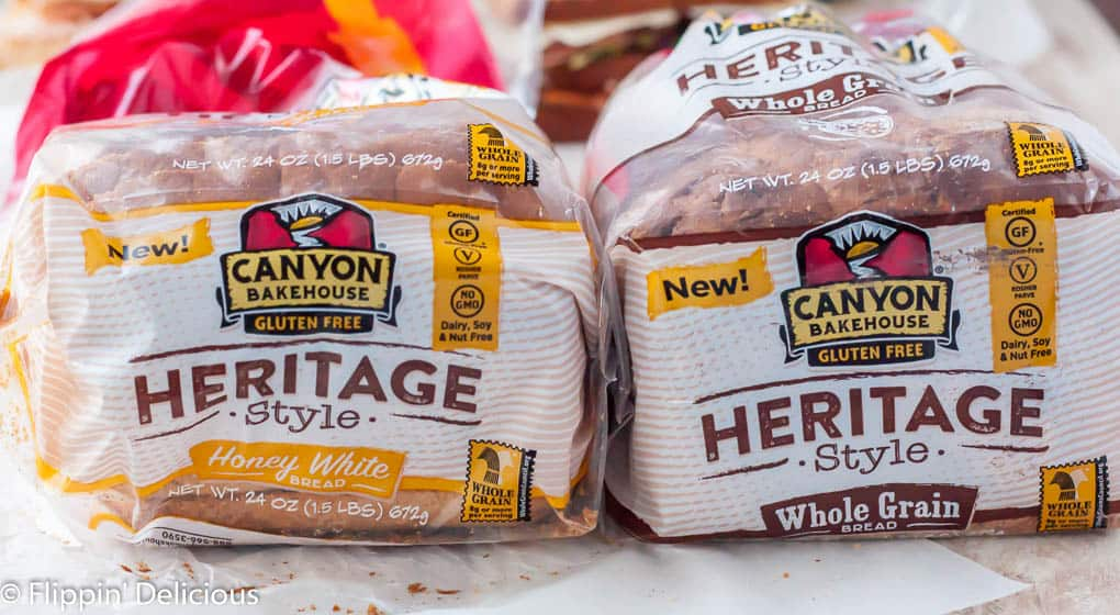 two loaves of canyon bakehouse gluten free bread side by side, heritage style honey white gluten free bread and heritage style gluten free whole grain bread