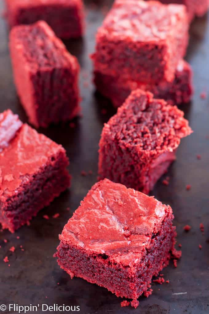 Gluten Free Red Velvet Brownies (dairy free, too) are chewy and fudgy with just a hint of cocoa and vanilla.