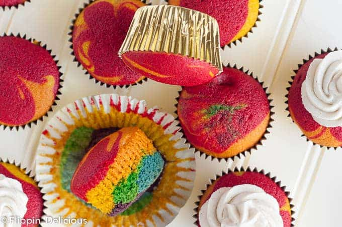Gluten-Free Rainbow Cupcakes with vanilla frosting will make everyone swoon! Brightly-colored vanilla cupcakes with the perfect tender crumb, topped with a fluffy vanilla bean frosting. Whether you bake them up for the little leprechauns in your life or serve at a birthday party for the young-at-heart, they are sure to be a hit.