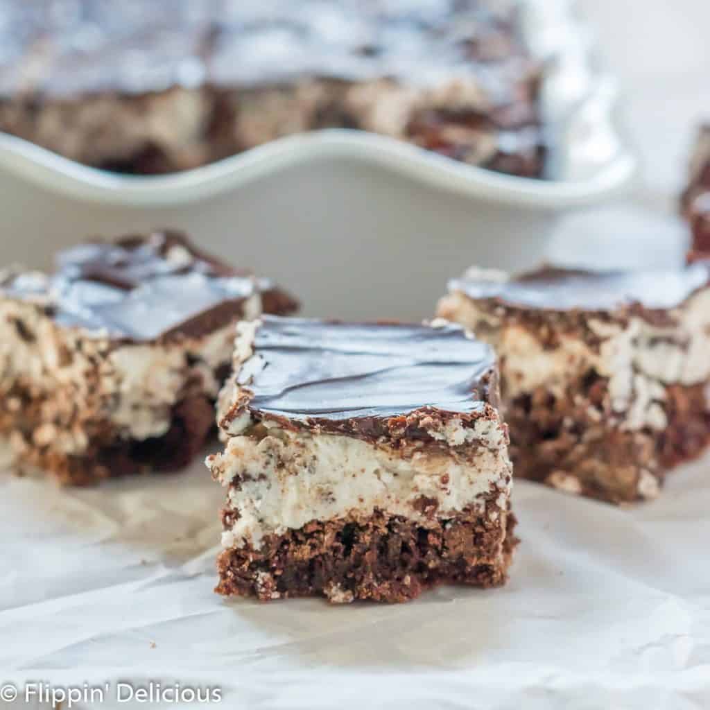 three gluten free cookie and cream brownies on a piece of parchment paper
