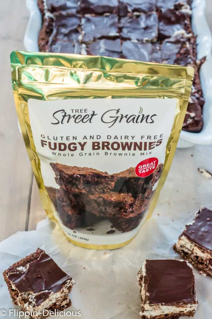 Tree Streen Grains Gluten and dairy free fudgy brownie mix on table with cookies and cream brownies