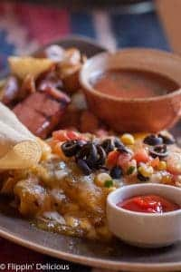 gluten free new mexican huevos rancheros with melted cheese and olives