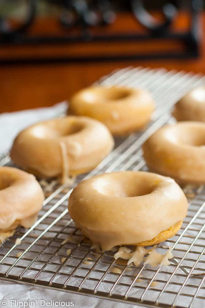 Tender gluten-free pumpkin donuts with maple glaze make the perfect allergy-friendly fall treat!