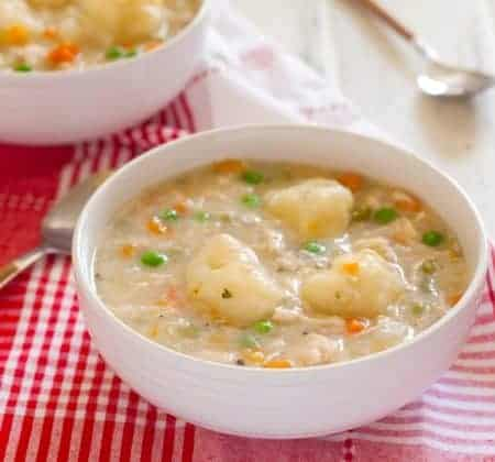Gluten-free chicken and dumplings will warm your belly and your soul! This comfort food couldn't be easier to make safe for everyone to eat.