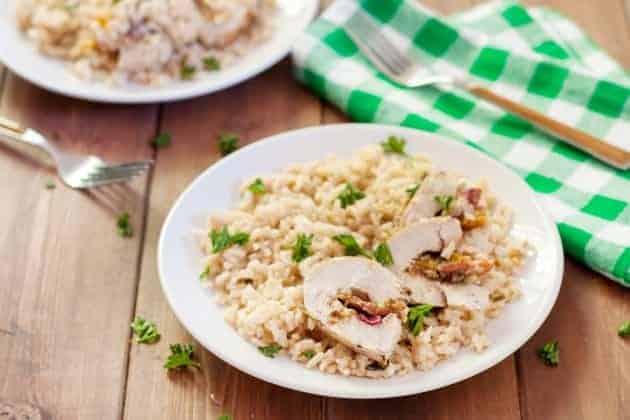stuffed turkey tenderloin on a plate with rice